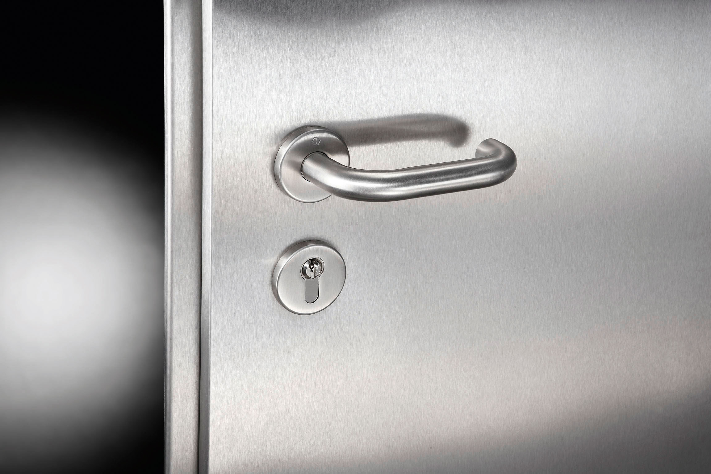 Steel door and handle