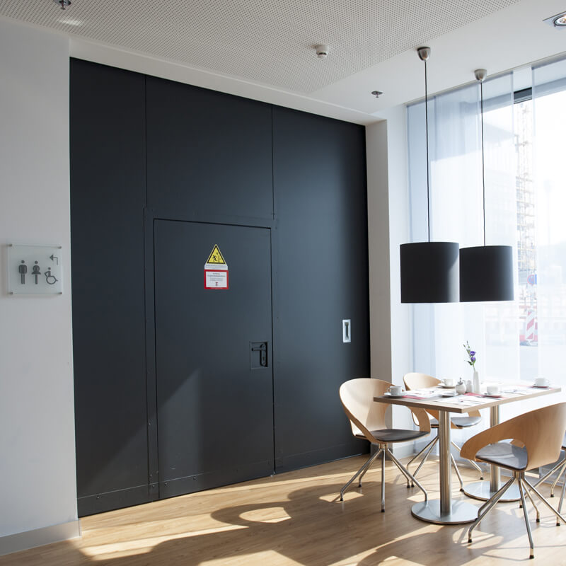 "Fire-resistant steel sliding door T90-1-FSA ""Teckentrup E"" Dividing A Hotel Space"