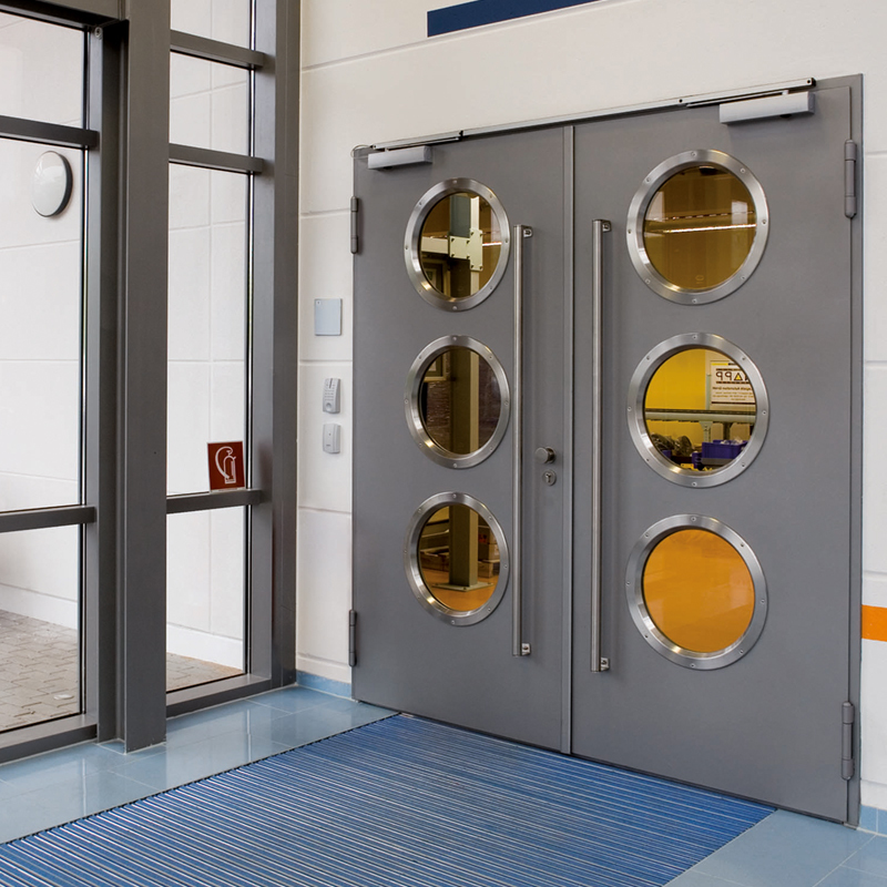 High Frequency Closers Fitted To Deparetment Entrance Doors With Porthole Windows And D Handles