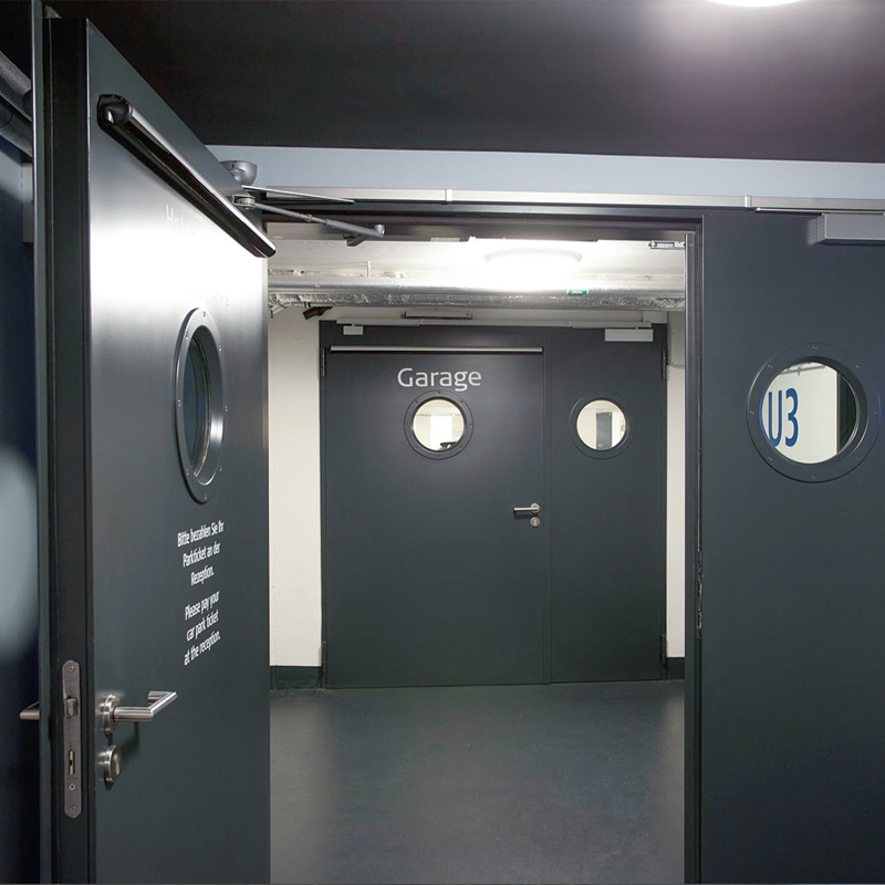 A Pair Of Double Steel Fire Doors Protecting A Car Park Access Corridor