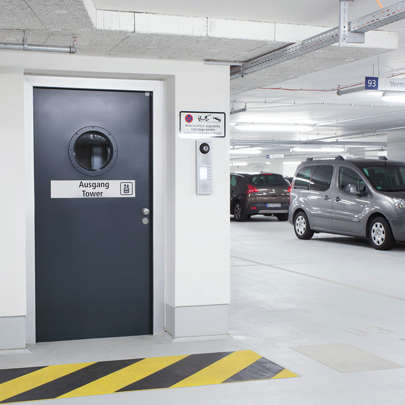 Single Steel Fire Door With Porthole Vision Panel Protecting A Carpark Access Point