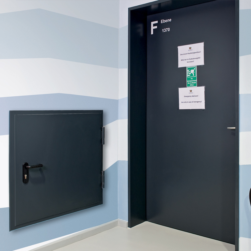 Steel Fire Door And A Steel Fire Hatch Protecting A Hotel Corridor And Utilities Shaft