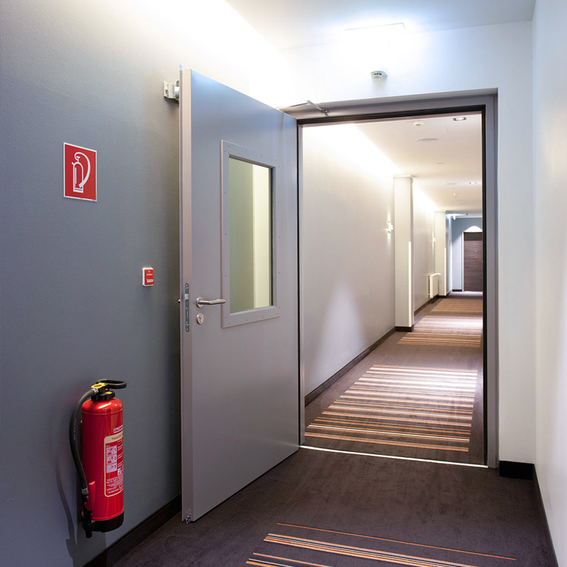 Steel Fire Door With Vision Panel Integrated Into A Hotel Fire System