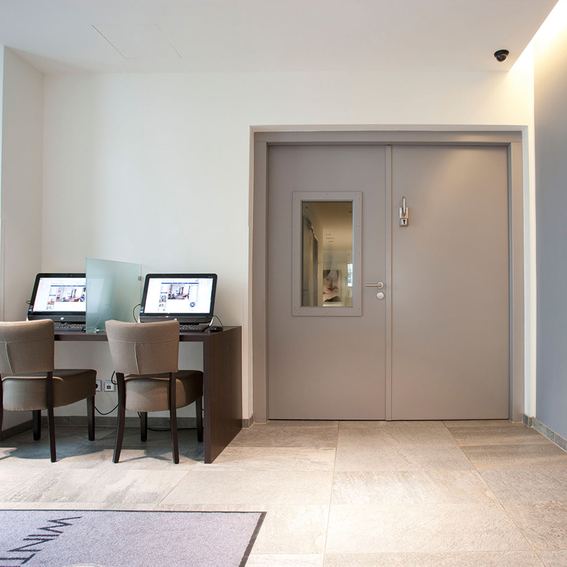 Dobele Steel Fire Door With Vision Panel Integrated Protecting A Hotel Lobby